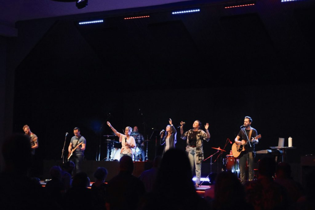 church worship band on stage singing and playing instruments
