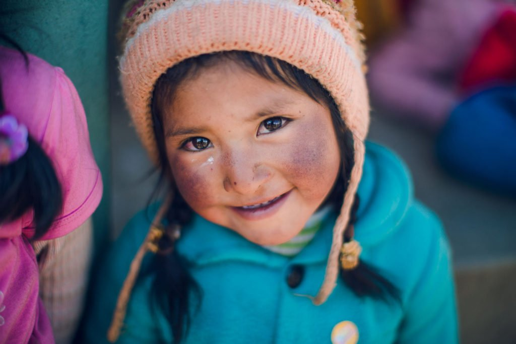 missionary peruvian little girl with beautiful eyes and pink hat